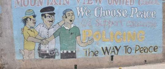 A mural painted by the citizens of the Mountain View community shows their partnership and support for the Jamaica Constabulary Force. USAID